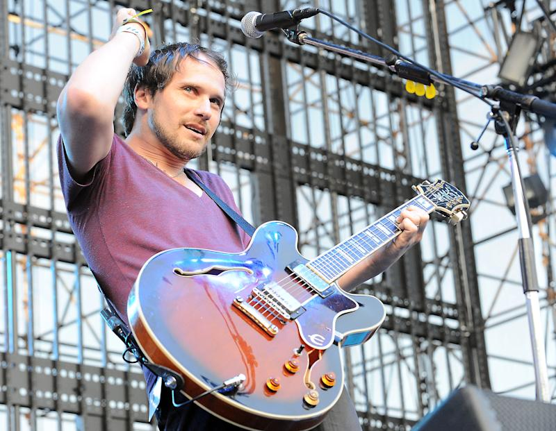 """FILE - This June 5, 2010 file photo shows Brian Aubert of Silversun Pickups performing at The 2010 KROQ Weenie Roast at The Verizon Wireless Amphitheater in Irvine, Calif. The Silversun Pickups want Mitt Romney's presidential campaign to immediately stop the use of the rock group's song """"Panic Switch."""" And the Romney campaign has no problem with that.  The Los Angeles-based band's attorney sent a cease and desist letter to the Republican presidential candidate's campaign on Wednesday. A news release says neither the band nor its representatives were contacted for permission to use the 2009 alternative rock hit and the group """"has no intention of endorsing the Romney campaign.""""  (AP Photo/Katy Winn, file)"""