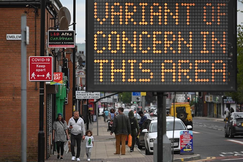 <p>Public health digital board warns the public of a Covid-19 variant of concern affecting the community in Bolton</p> (AFP via Getty Images)