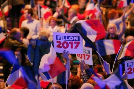 A supporter holds a board during Francois Fillon's campaign rally in Caen