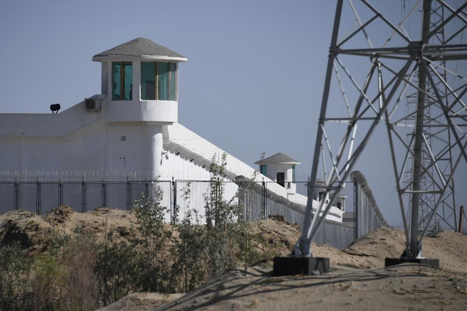 This photo taken on May 31, 2019 shows watchtowers on a high-security facility near what is believed to be a re-education camp where mostly Muslim ethnic minorities are detained, on the outskirts of Hotan, in China's northwestern Xinjiang region.
