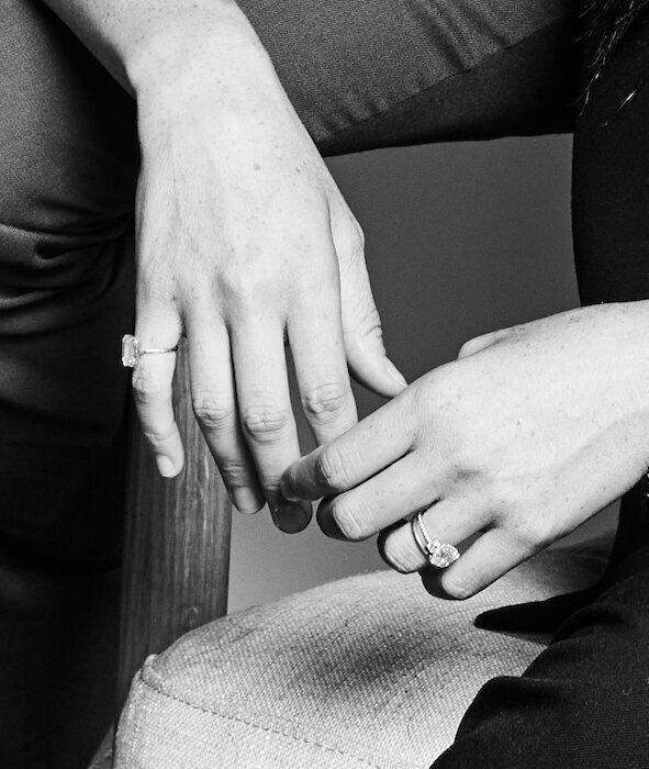 A close-up of Meghan Markle's hands, showing her pinky ring and her engagement ring. (Photo: Matt Sayles/Time magazine)