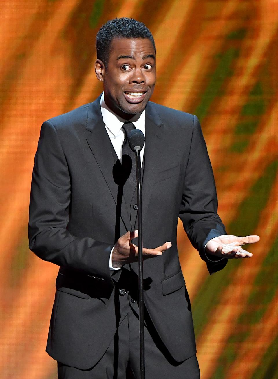 HOLLYWOOD, CALIFORNIA - MARCH 30: Chris Rock speaks onstage at the 50th NAACP Image Awards at Dolby Theatre on March 30, 2019 in Hollywood, California. (Photo by Earl Gibson III/Getty Images for NAACP)