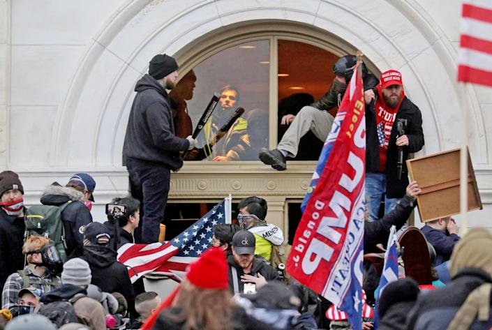 Image: FILE PHOTO: The U.S. Capitol Building is stormed by a pro-Trump mob on Jan. 6, 2021 (Leah Millis / Reuters file)