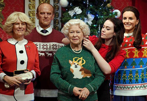 The Duchess of Cornwall in the classic tacky Santa look. (Photo: AP)