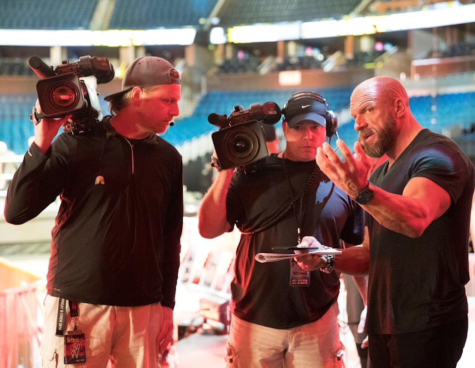 Paul 'Triple H' Levesque speaks to a camera crew prior to an NXT event. (Photo courtesy of WWE)