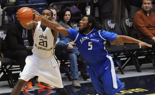 Saint Louis forward Jordair Jett (5) steals the ball away from George Washington forward Lasen Kromah (20) during first half of their NCAA college basketball game, Saturday, March 2, 2013, in Washington. (AP Photo/Richard Lipski)