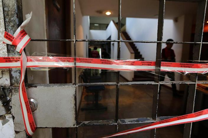 View of the entrance to building of the Center of Investigation on Communication (CINCO) after the NGO was raided in Managua on December 14, 2018 (AFP Photo/Inti Ocon)