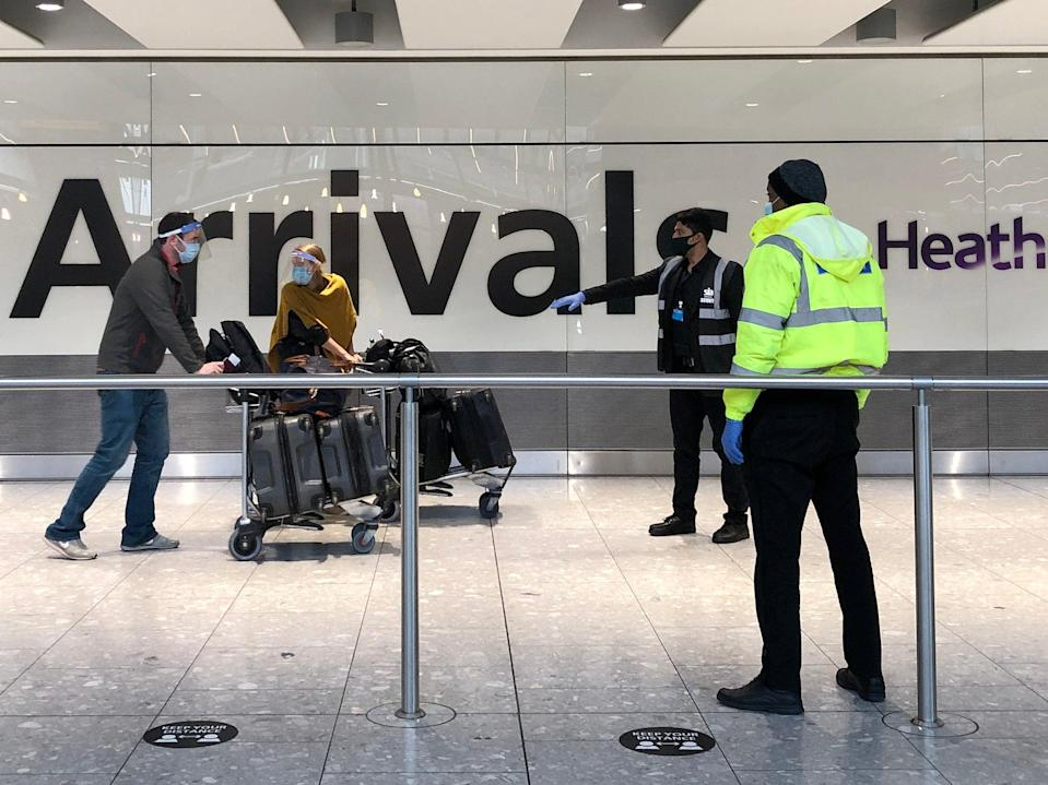 <p>Passengers arriving at Heathrow are directed towards coaches bound for quarantine hotels </p> (Getty Images)