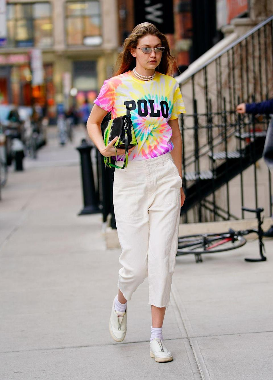<p>Tie-dye is like a solid black and white stripe – it goes with anything in your closet (seriously, try it). Pair the multi-colored design with a printed skirt, cut-offs, or white jeans for the ultimate cool-girl look. </p>