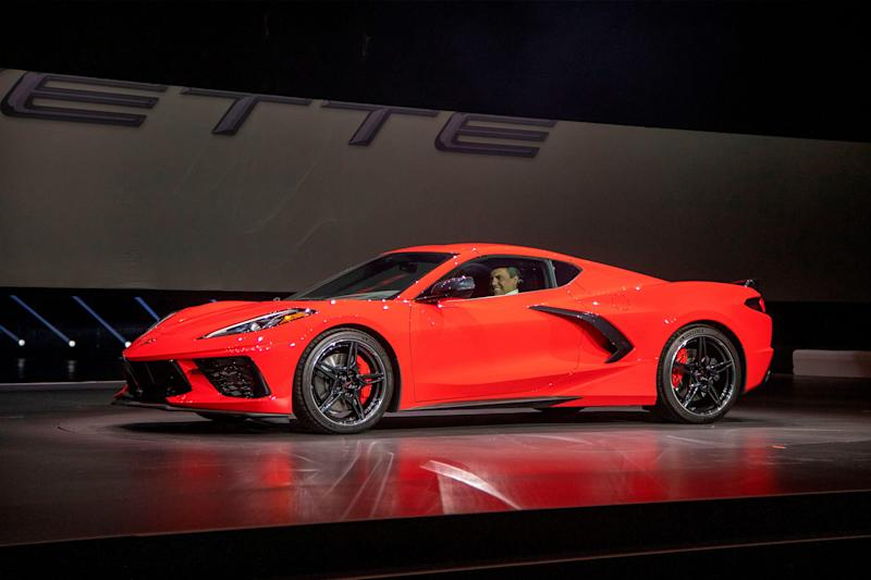 Barry Engle, executive vice president and president of General Motors International, drives onstage in the new 2020 Corvette Stingray during the Next Generation Corvette Reveal event in Irvine, California on July 18, 2019.