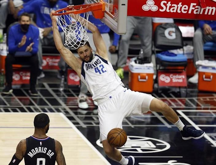 LOS ANGELES, CA - MAY 25: Dallas Mavericks forward Maxi Kleber (42) slam dunks the ball in a game against the LA Clippers in the first period at the Staples Center on Tuesday, May 25, 2021 in Los Angeles, CA. Game two of the NBA Western Conference first-round playoff series. (Gary Coronado / Los Angeles Times)