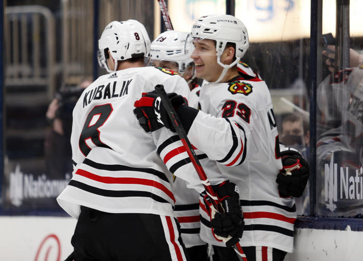 Chicago Blackhawks forward Philipp Kurashev, right, celebrates his goal against the Columbus Blue Jackets with teammate forward Dominik Kubalik, left, and forward Patrick Kane during the third period of an NHL hockey game in Columbus, Ohio, Monday, April 12, 2021. The Blackhawks won in overtime. (AP Photo/Paul Vernon)