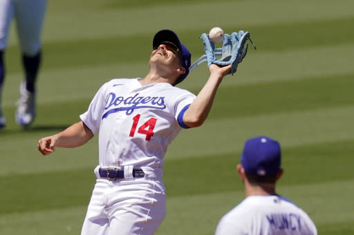 Los Angeles Dodgers shortstop Kik Hernndez makes a catch on a ball hit by San Francisco Giants' Mike Yastrzemski during the third inning of a baseball game Sunday, Aug. 9, 2020, in Los Angeles. (AP Photo/Mark J. Terrill)