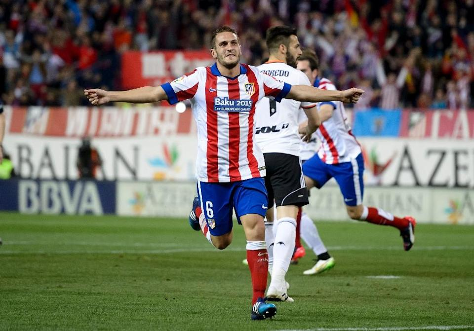 Atletico Madrid's midfielder Koke celebrates after scoring during the match Atletico Madrid vs Valencia on March 8, 2015 (AFP Photo/Dani Pozo)