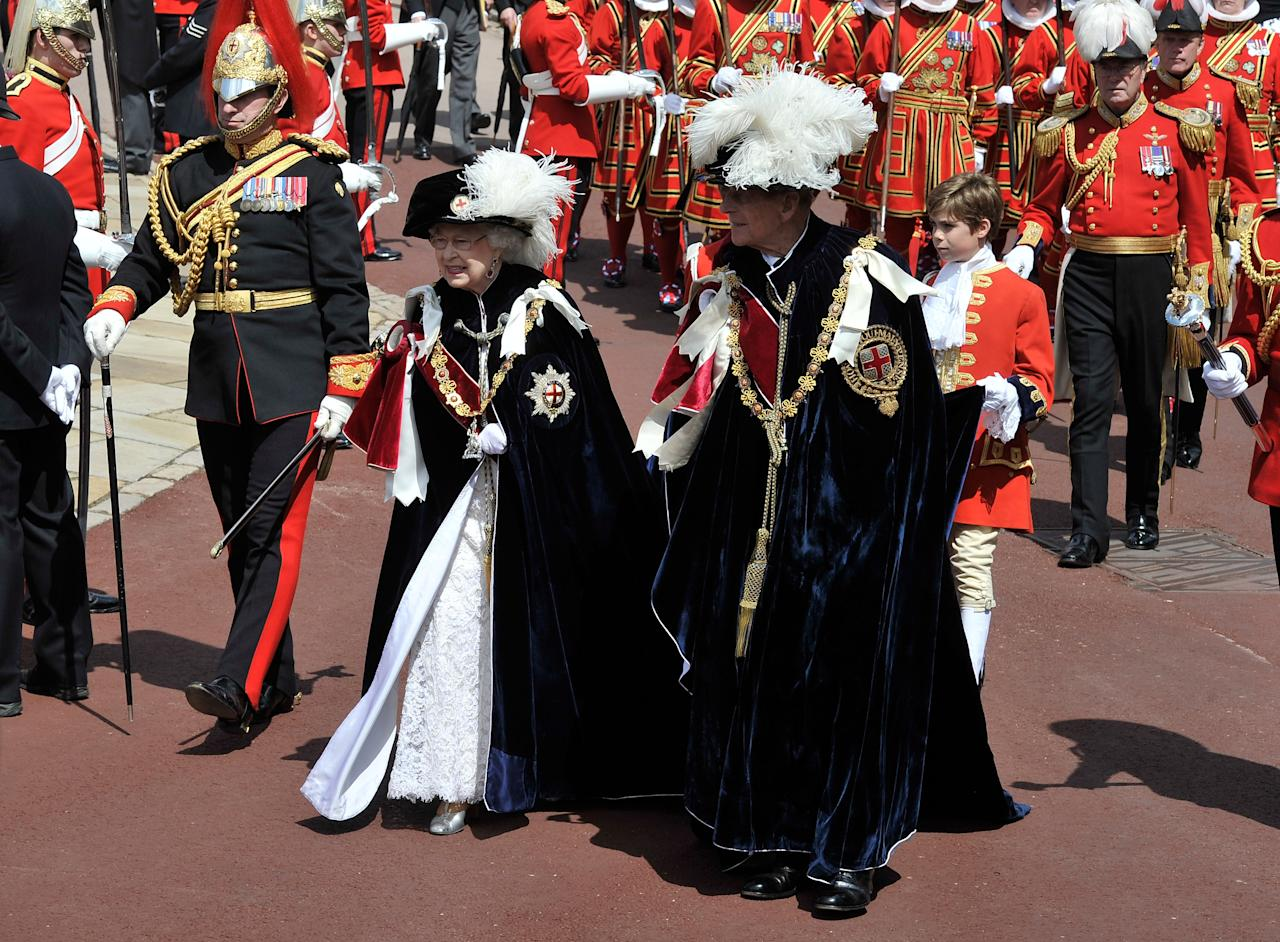 WINDSOR, ENGLAND - JUNE 18:  Queen Elizabeth II and Prince Philip, Duke of Edinburgh attend the annual Order of the Garter Service at St George's Chapel, Windsor Castle on June 18, 2011 in Windsor, England. The Order of the Garter is the senior and oldest British Order of Chivalry, founded by Edward III in 1348. Membership in the order is limited to the sovereign, the Prince of Wales, and no more than twenty-four members.  (Photo by Gareth Cattermole - WPA Pool/Getty Images)