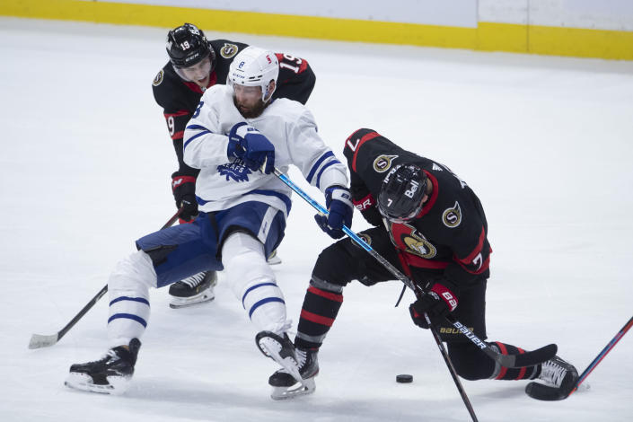 Ottawa Senators right wing Drake Batherson (19) looks on as teammate Brady Tkachuk collides with Toronto Maple Leafs defenseman Jake Muzzin (8) during the second period of an NHL hockey game in Ottawa, Ontario, Saturday, Jan. 16, 2021. (Adrian Wyld/The Canadian Press via AP)