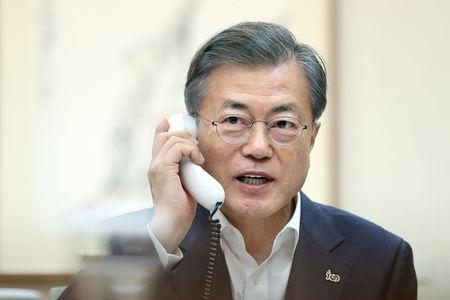 South Korean President Moon Jae-in talks on the phone with U.S. President Donald Trump at the Presidential Blue House in Seoul, South Korea, February 28, 2019.   The Presidential Blue House/Yonhap via REUTERS/File Photo