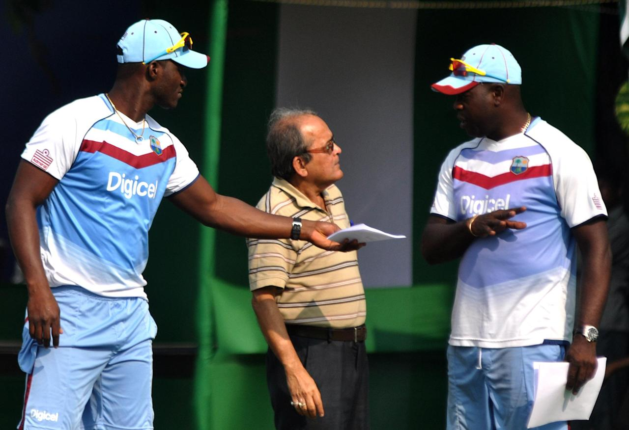 West Indian players Darren Sammy and Ottis Gibson during practice sessions at Salt Lake stadium in Kolkata on Oct.30, 2013. (Photo: IANS)