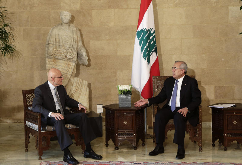 Lebanese Prime Minister designate Tammam Salam, left, meets with President Michel Suleiman at the presidential palace in Baabda, east of Beirut, Lebanon, Saturday, April 6, 2013. Following two days of consultations, President Suleiman asked legislator and former Minister of Culture Salam to form the new Cabinet after 124 of the 128-member parliament chose him for the job.  (AP Photo/Hassan Ammar)