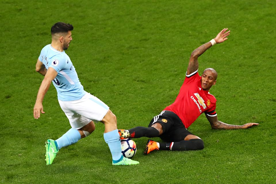 Ashley Young brings down Sergio Aguero in the Manchester derby but no penalty is given. Manchester Utd win the game and City must wait to win the title. (7 April 2018)