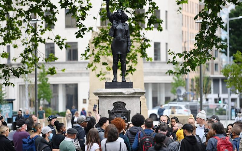 People gather to view the sculpture, by local artist Marc Quinn - Getty Images Europe