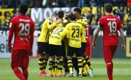 Borussia Dortmund's Sokratis Papastathopoulos celebrates scoring their second goal with teammates