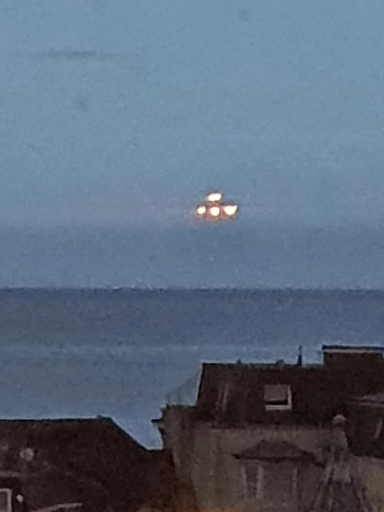 This is the moment a  student captured a large UFO hovering