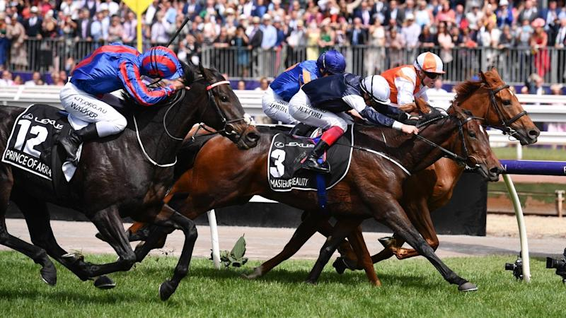 Australian stayer Vow And Declare (inside) has repelled the overseas challenge in the Melbourne Cup