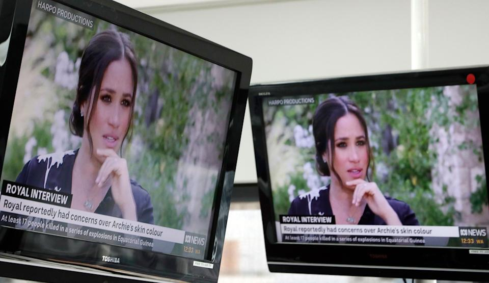 Australian television news in Sydney on March 8, 2021, reports on an interview of The Duke and Duchess of Sussex by Oprah Winfrey. (Photo: Rick Rycroft/AP)