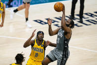 Brooklyn Nets guard James Harden (13) shoots over Indiana Pacers guard Justin Holiday (8) during the second half of an NBA basketball game in Indianapolis, Wednesday, March 17, 2021. (AP Photo/Michael Conroy)