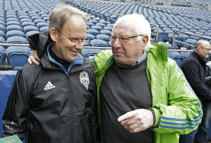 Former Seattle Sounders North American Soccer League coach Alan Hinton, left, has some advice for current Sounders MLS soccer head coach Brian Schmetzer, left, following a training session, Friday, March 17, 2017, in Seattle. The Sounders will face the New York Red Bulls in their home opener MLS soccer match Sunday, March 19, 2017. (AP Photo/Ted S. Warren)