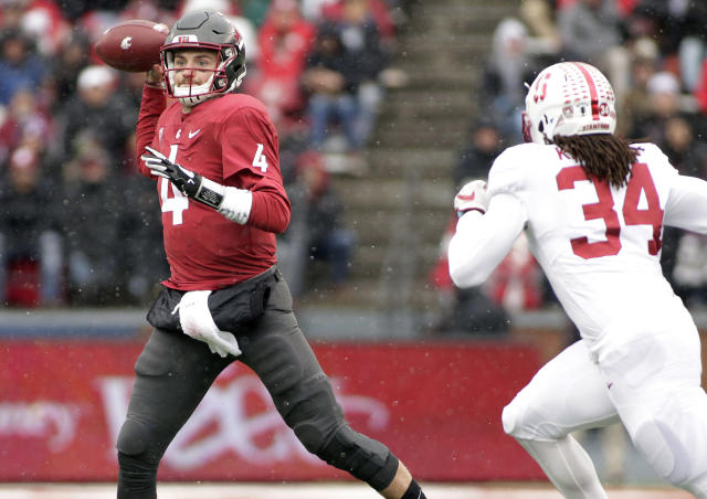 "Washington State quarterback <a class=""link rapid-noclick-resp"" href=""/ncaaf/players/230552/"" data-ylk=""slk:Luke Falk"">Luke Falk</a> (4) throws a pass as he is chased by Stanford linebacker <a class=""link rapid-noclick-resp"" href=""/ncaaf/players/227119/"" data-ylk=""slk:Peter Kalambayi"">Peter Kalambayi</a> (34) during the first half of an NCAA college football game in Pullman, Wash., Saturday, Nov. 4, 2017. (AP Photo/Young Kwak)"