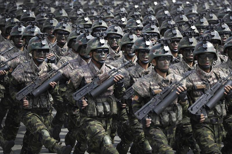 Show: Commandoes march across the Kim Il Sung Square (AP)