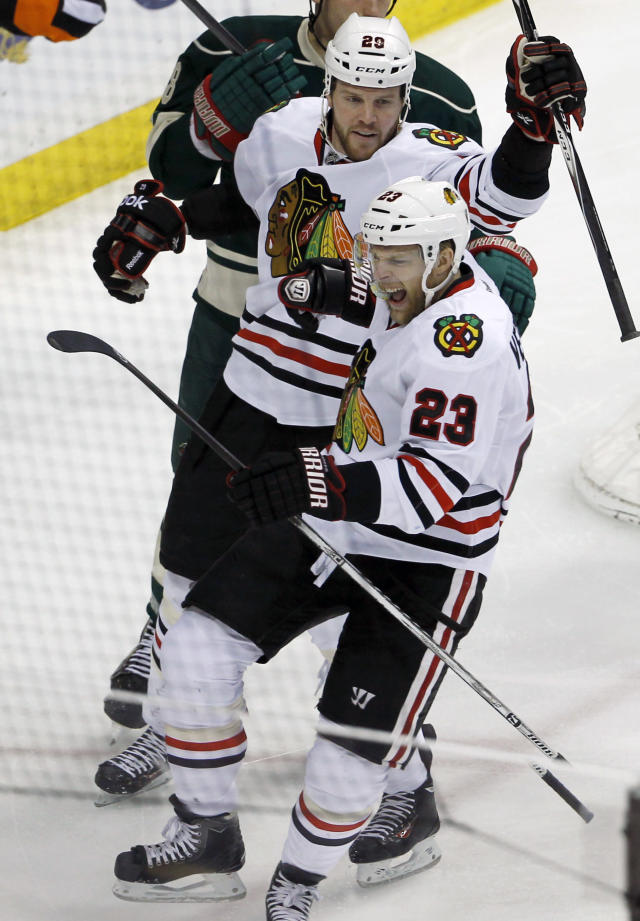 Chicago Blackhawks right wing Kris Versteeg (23) reacts in front of Blackhawks left wing Brandon Saad (20) after scoring on Minnesota Wild goalie Ilya Bryzgalov during the first period of Game 6 of an NHL hockey second-round playoff series in St. Paul, Minn., Tuesday, May 13, 2014. (AP Photo/Ann Heisenfelt)