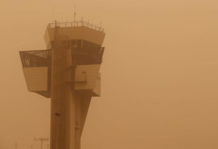 """Control tower is pictured during a sandstorm blown over from North Africa known as """"calima"""" at Las Palmas Airport"""