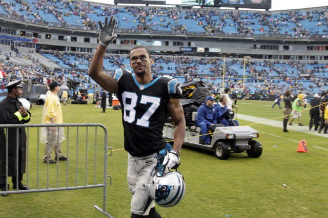 Carolina Panthers' Domenik Hixon (87) waves to fans after an NFL football game against the New Orleans Saints in Charlotte, N.C., Sunday, Dec. 22, 2013. The Panthers won 17-13. (AP Photo/Bob Leverone)