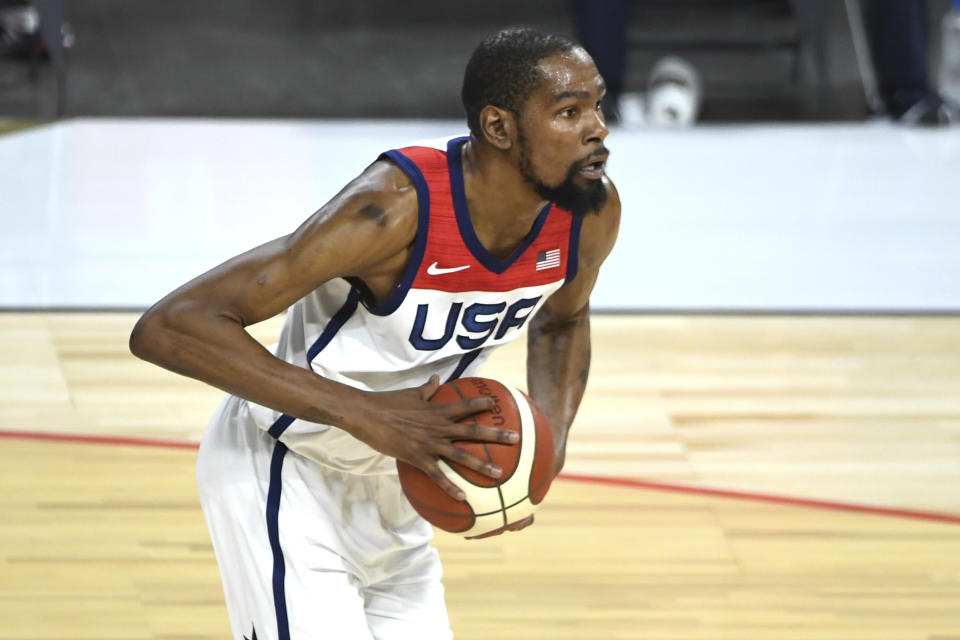 United States' Kevin Durant (7) holds the ball during an exhibition basketball game aganst Nigeria Saturday, July 10, 2021, in Las Vegas. (AP Photo/David Becker)