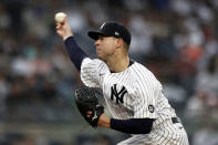 New York Yankees pitcher Corey Kluber delivers to the Baltimore Orioles during the second inning of a baseball game on Sunday, Sept. 5, 2021, in New York. (AP Photo/Adam Hunger)