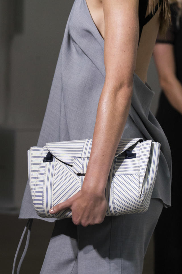 <p><i>Pinstriped clutch from the SS18 Jason Wu collection. (Photo: ImaxTree) </i></p>