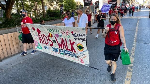 For more than 30 years, ACT has held an AIDS walk in Toronto. On Sunday, the agency held its last walk, after transforming into a 'Rally for Health.' (Michael Charles Cole/CBC - image credit)