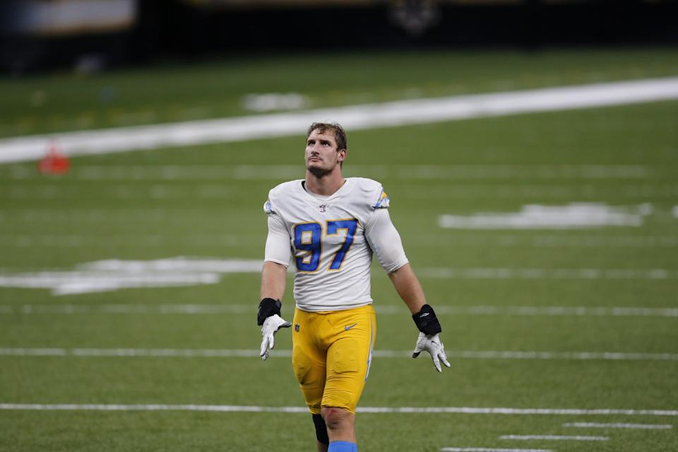 Chargers defensive end Joey Bosa walks off the field after a loss to the Saints on Oct. 12.