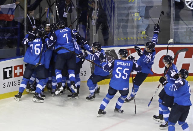 Finland players celebrate after scoring their fifth goal during the Ice Hockey World Championships quarterfinal match between Finland and Sweden at the Steel Arena in Kosice, Slovakia, Thursday, May 23, 2019. (AP Photo/Petr David Josek)