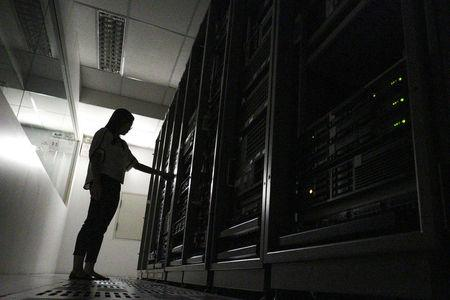 An employee works inside a server room at a company in Bangkok