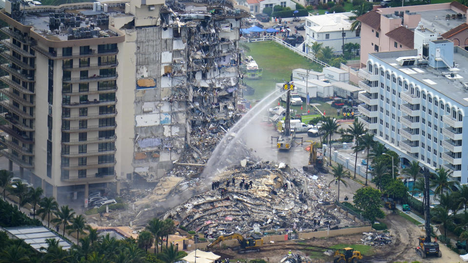 Rescue personnel work at the remains of the Champlain Towers South Condo in Surfside, Fla., on Friday, June 25, 2021. The seaside tower collapsed on Thursday. (AP Photo/Gerald Herbert)