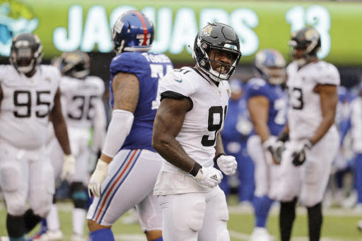 FILE - In this Sept. 9, 2018, file photo, Jacksonville Jaguars defensive end Yannick Ngakoue reacts during the second half of an NFL football game against the New York Giants, in East Rutherford, N.J. The Jaguars, who ranked second in the NFL with 55 sacks in 2017, have four in two games _ on pace for 32 this season. Jacksonville hopes to end the trend against AFC South rival Tennessee on Sunday. (AP Photo/Seth Wenig, File)