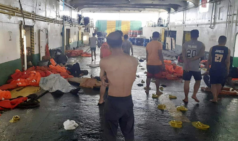 In this photo provided by Philippine Coast Guard in Manila, rescued passengers of the ill-fated M/V Lite Ferry 16, are attended to by the coast guard rescuers and crew of responding vessels, on a ferry which responded to the incident, following a ferry fire Wednesday, Aug. 28, 2019, off Dapitan city in Zamboanga del Norte province in southern Philippines. (Philippine Coast Guard via AP)
