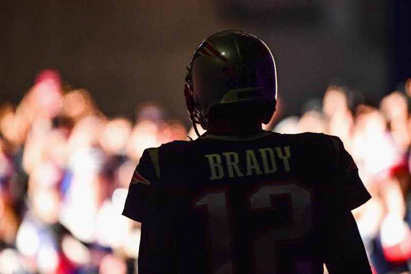 FOXBORO, MA - NOVEMBER 26: Tom Brady #12 of the New England Patriots exits the tunnel before a game against the Miami Dolphins at Gillette Stadium on November 26, 2017 in Foxboro, Massachusetts. (Photo by Billie Weiss/Getty Images)