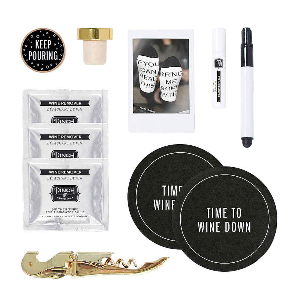 """<h2>Pinch Provisions Wine Night Kit</h2><br>This cute little curated kit contains a collection of wine-centric accessories — including glass markers, coasters, stain removing spray, """"If you can read this, bring me some wine"""" socks, a sip-decision game coin, wine-removing towelettes, and a gold-tone stopper plus corkscrew. <br><br><em>Shop <strong><a href=""""https://www.jcrew.com/c/womens_category/brandswelove/brand-pinch-provisions"""" rel=""""nofollow noopener"""" target=""""_blank"""" data-ylk=""""slk:Pinch Provisions"""" class=""""link rapid-noclick-resp"""">Pinch Provisions</a></strong></em><br><br><strong>Pinch Provisions</strong> Wine Night Kit, $, available at <a href=""""https://go.skimresources.com/?id=30283X879131&url=https%3A%2F%2Fwww.revolve.com%2Fwine-night-kit%2Fdp%2FPPRO-WU40%2F%3Fd%3DWomens"""" rel=""""nofollow noopener"""" target=""""_blank"""" data-ylk=""""slk:Revolve"""" class=""""link rapid-noclick-resp"""">Revolve</a>"""