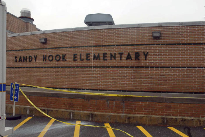 This December 2012 photo released by the Connecticut State Police on Friday, Dec. 27, 2013, shows a scene at Sandy Hook Elementary School in Newtown, Conn. Adam Lanza gunned down 20 first-graders and six educators with a semi-automatic rifle at the school on Dec. 14, 2012, after killing his mother inside their home. Lanza committed suicide with a handgun as police arrived at the school. (AP Photo/Connecticut State Police)