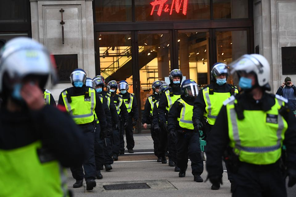 <p>Police lined the streets around Oxford Circus</p>PA